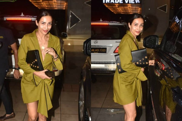 malaika arora looks stunning in deep neck dress