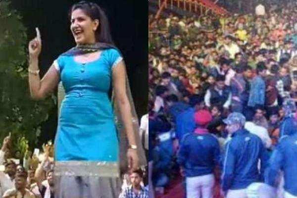 sapna chaudhary live show crowd gets mad and her brother firing in the air
