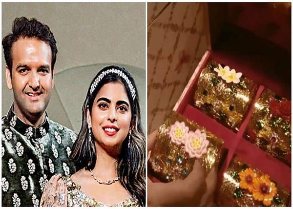 isha ambani and anand piramal wedding invite is all things royal