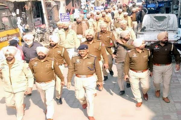 police march flag in view of panchayat elections