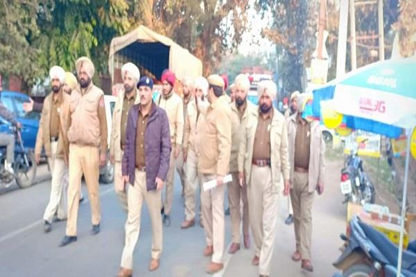 police march flag in villages