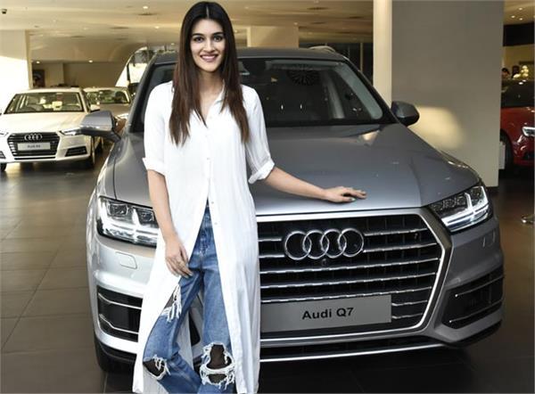 actress kriti sanon poses with her new audi q7 in mumbai