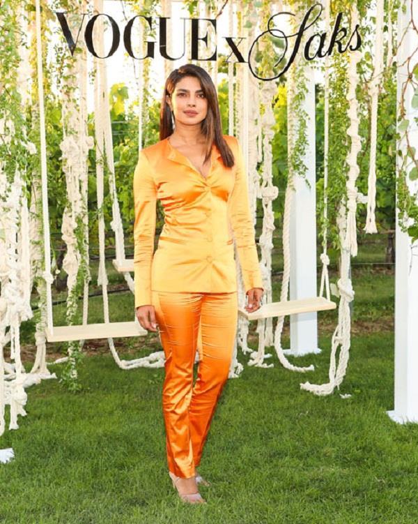 priyanka chopra looks stunning in orange for a fashion event