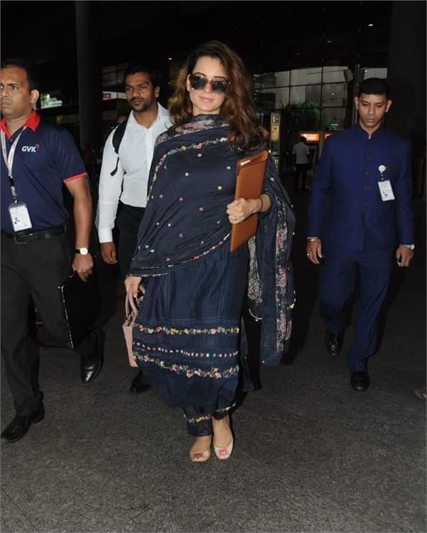 kangana spotted at airport in traditional look