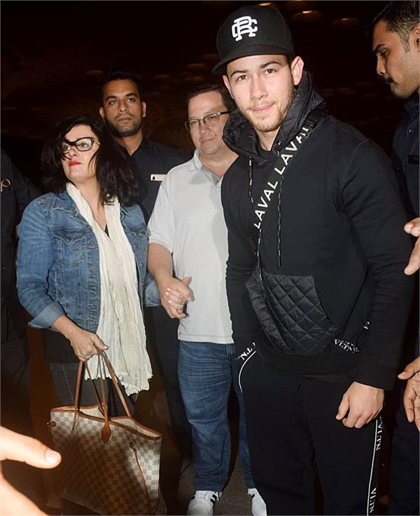 after engagement celebrations nick jonas and family leave for the us