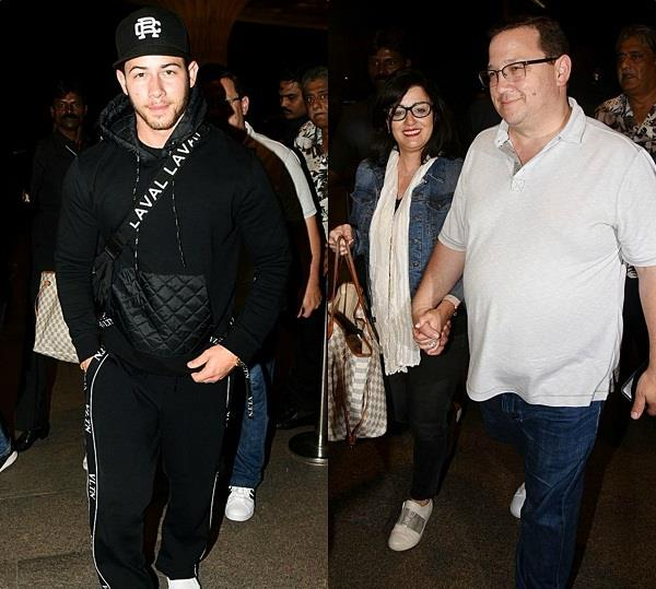 nick jonas and family leave for the usa