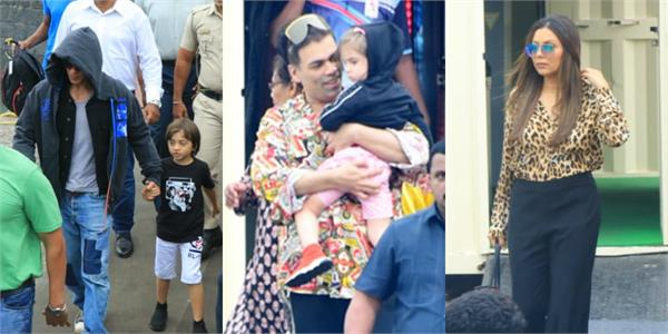 shahrukh khan with son abram karan johar and other stars leave for alibaug