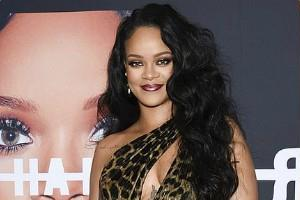 rihanna looks super stylish in leopard print dress