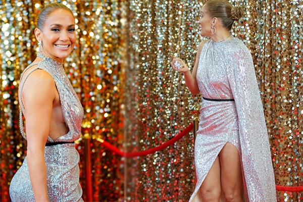 jennifer lopez goes braless in silver gown see pics