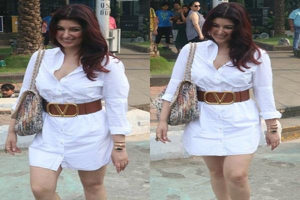 twinkle looked beautiful in a white casual dress posed for photographers