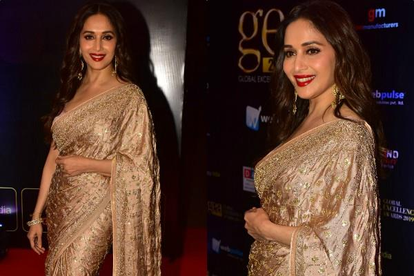 madhuri dixit looks beautiful in golden saree as she attends award