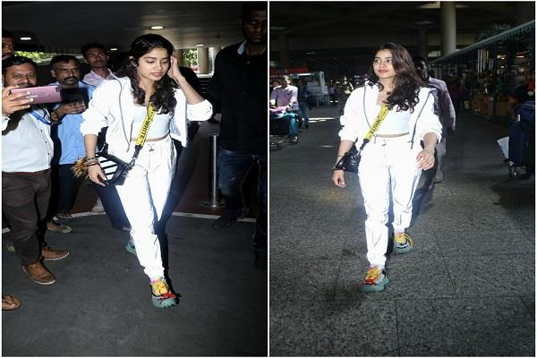 janhvi seen at the airport in crop top in white look