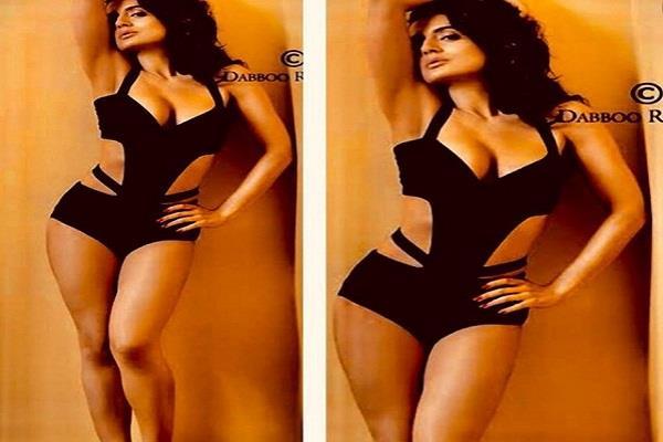 amisha patel shows hot looks in black bikini