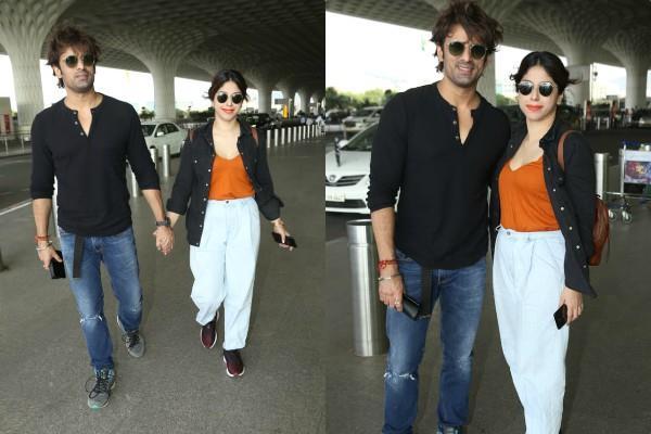 mohit malik spotted at mumbai airport with wife aditi shirwaikar