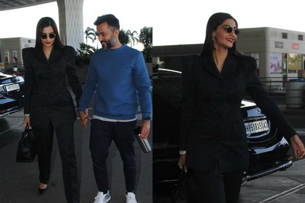sonam kapoor looks stunning as she spotted at airport with husband anand ahuja