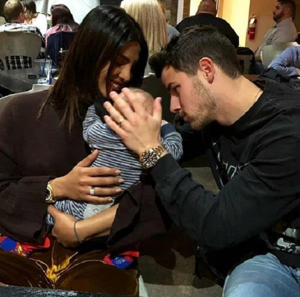 priyanka chopra nick jonas photo with a baby