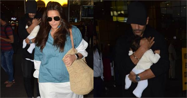 neha dhupia spotted at airport with angad mehar