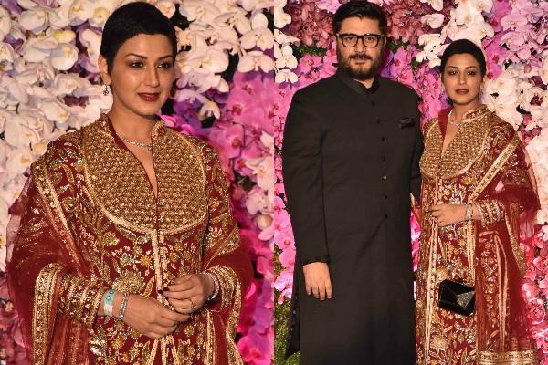 sonali with husband at akash shloka reception party