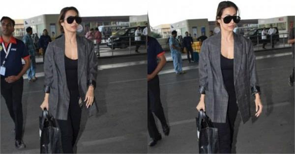 malaika arora pairs her airport look with rs 1 4 lakh bag