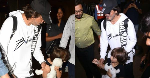 shahrukh khan with abram at mumbai airport