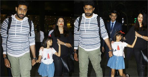 aishwarya rai bachchan with abhishek bachchan and aaradhya at mumbai airport