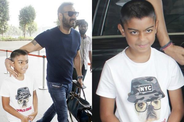 ajay devgan spotted with son yug at mumbai airport