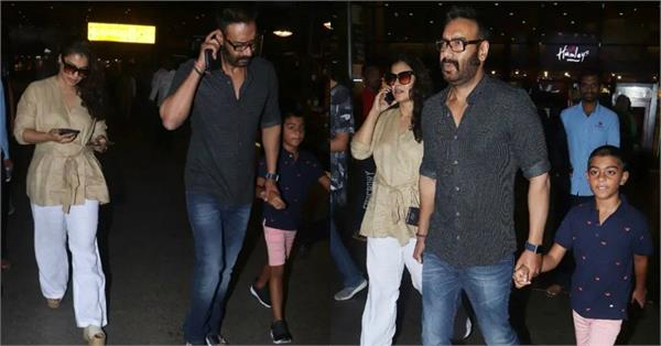 ajay devgan spotted with wife kajol and son yug at airport