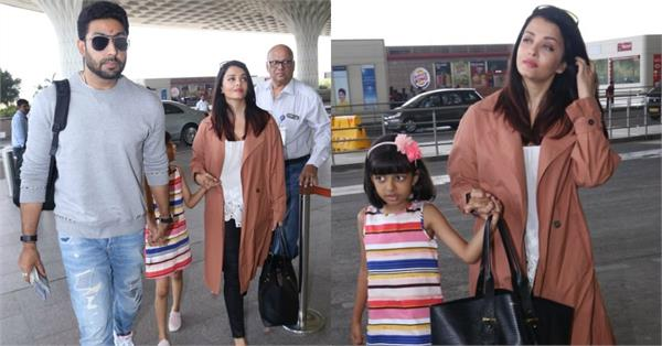 aishwarya spot at airport with abhishek aaradhya