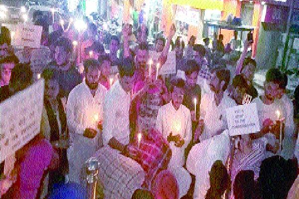 candle march extracted against the ill fated riots