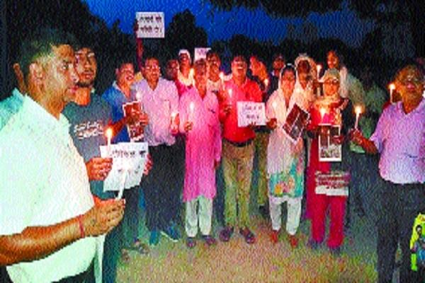 candle march released in protest against aligarh incident