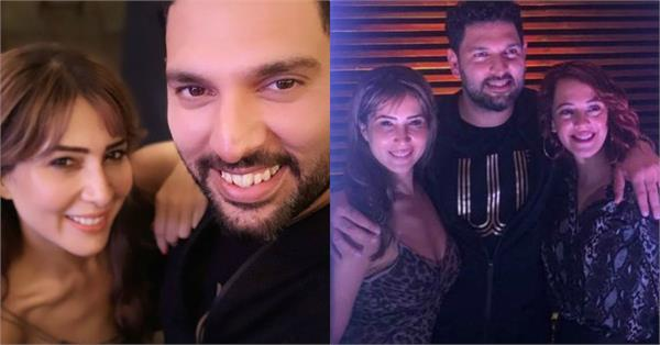 kim sharma poses with yuvraj singh and wife hazel keech at retirement party
