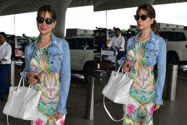 kim sharma snapped at airport