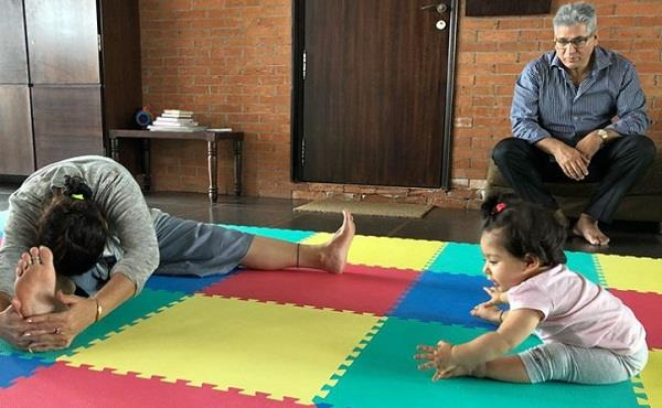 inaaya learning yoga from her grandmother
