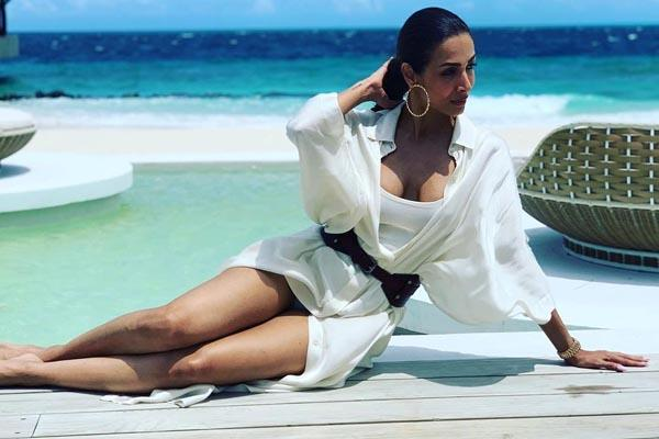 malaika arora share photo deep neck outfit from her maldives vacation