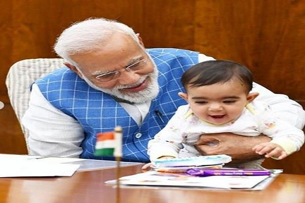 pm narendra modi shared picture little child
