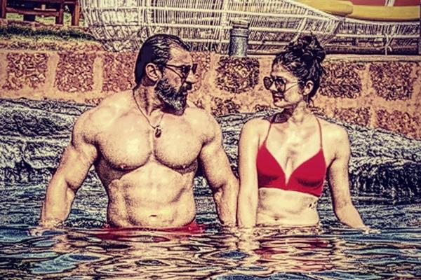 pooja batra chill in pool with husband nawab shah