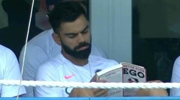 kohli seen sitting in dressing room reading a book troll on social media