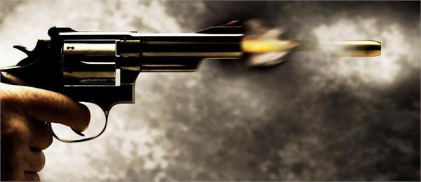 bullets fired on father son due to old envy both seriously injured
