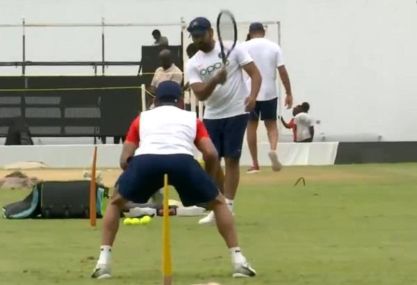 rohit was seen making captain kohli a caching practice video viral