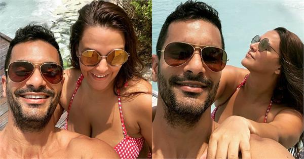 neha dhupia red bikini pictures viral with husband angad bedi