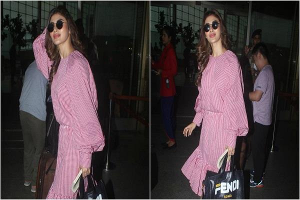 mouni roy spotted at mumbai airport in pink check western dress