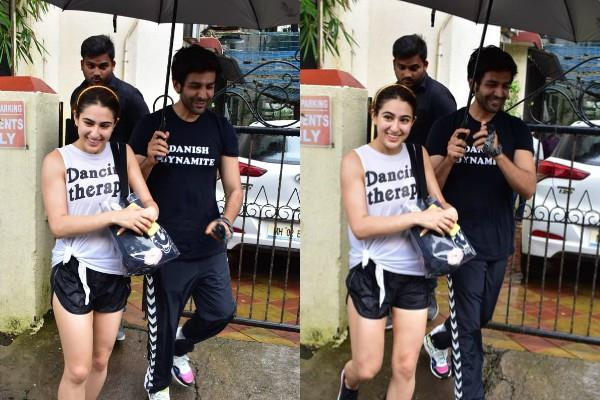 kartik aryan holds umbrella for sara ali khan outside the dance class