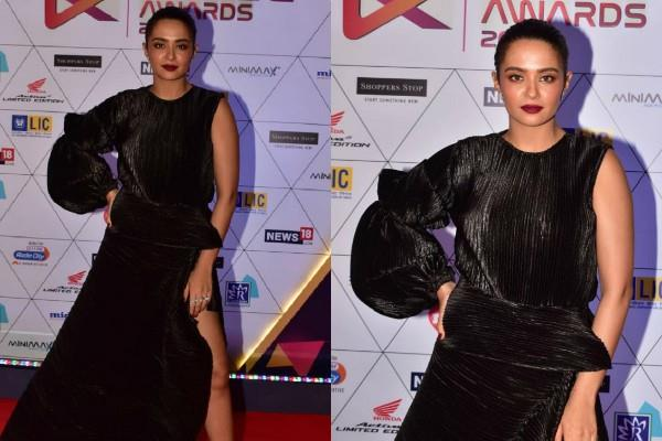 surveen chawla flaunts her perfect figure in high slit gown