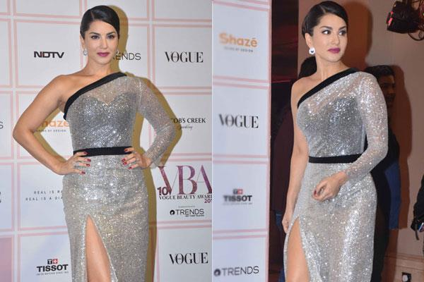 sunny leone posed in special style on the black carpet