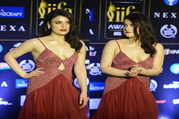 radhika madan appeared in a deep cleavage red gown