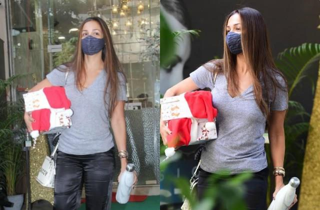 malaika arora snapped with christmas goodies after her salon visit