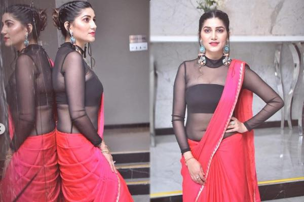 sapana chaudhary in read saree see latest photos