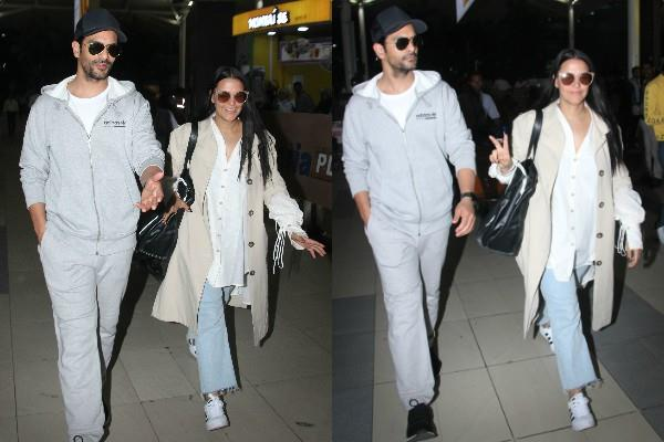 neha dhupia spotted at airport with angad bedi