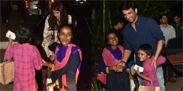 rhea chakraborty distributing food packets to children with sushant singh