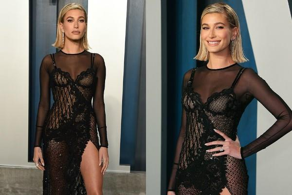 hailey bieber flaunts toned leg in black dress